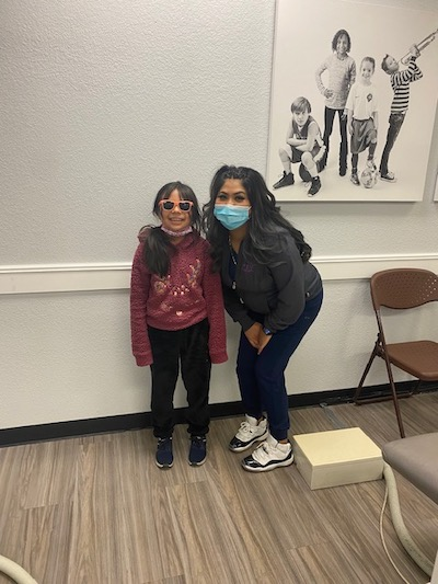 dental hygienist with pediatric dental patient