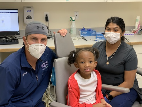 dentist and hygienist with pediatric patient